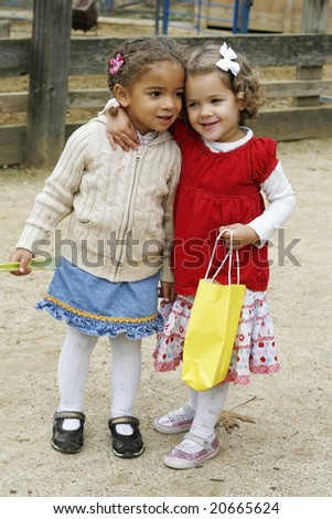 two adorable toddler girls - stock photo