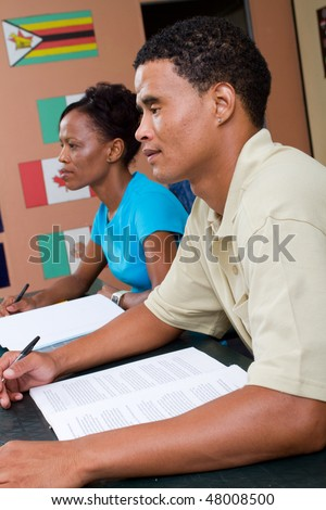 two adult african american students in classroom - stock photo