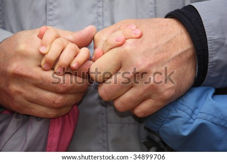 Two adult and two children's hands