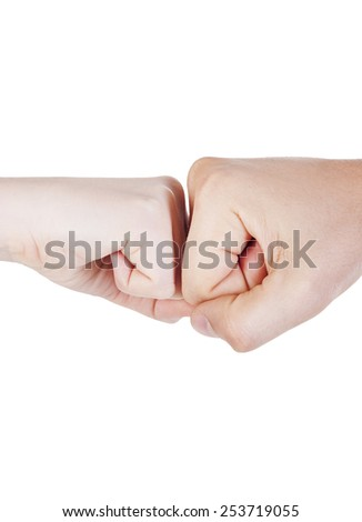 Two adult arms together in fight - stock photo