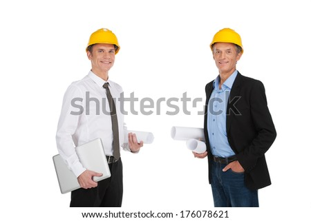 two adult people holding papers. businessmen standing together happy and smiling - stock photo