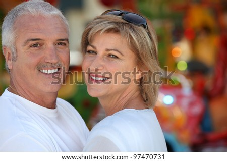 Two adults at funfair - stock photo