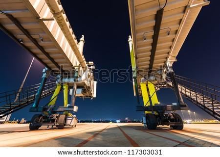 two aerobridge at night - stock photo