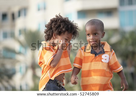 Two African American brothers in the park - stock photo
