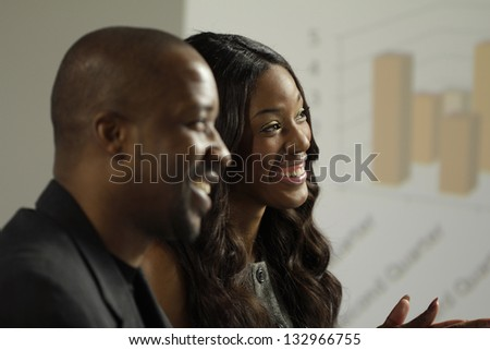 Two African American business man and woman in a meeting - stock photo
