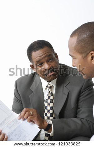 Two African American businessmen with paperwork - stock photo
