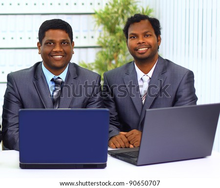 Two african-american in the office work of the laptop. - stock photo