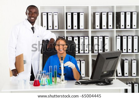 two african american scientists in lab - stock photo