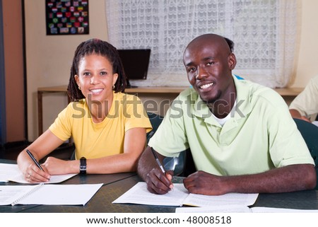 two african american students in classroom - stock photo