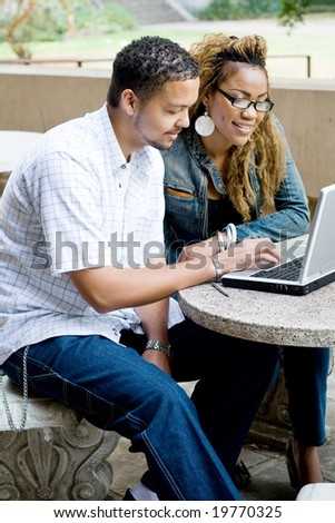 two african college students study computer together - stock photo