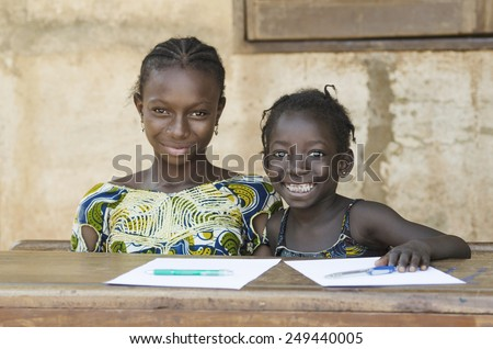Two African Ethnicity Children Smiling Studying in a School Environment (Schooling Education Symbol) - stock photo