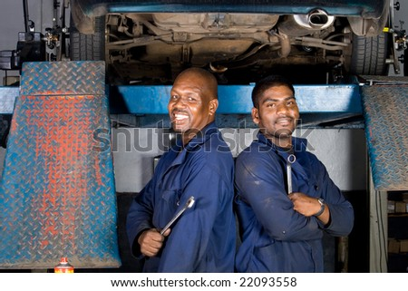 two african mechanic in side garage - stock photo