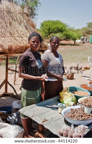 two African street vendors selling local products - stock photo
