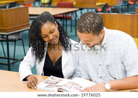 two african students study books in library - stock photo