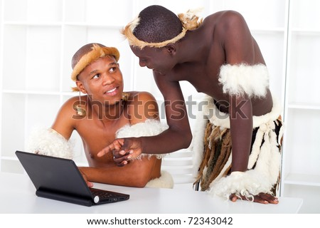 two african tribesman learning computer - stock photo