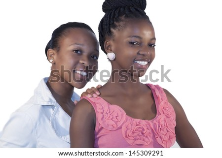 Two African woman smiling on white background
