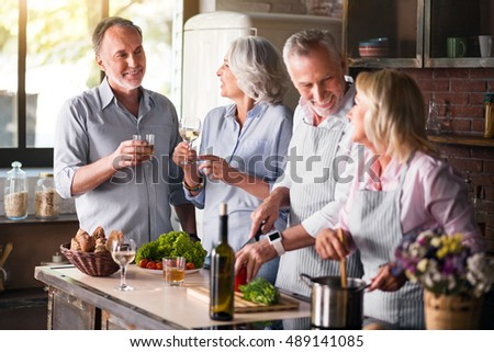 Two aged families getting together for lunch