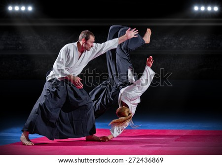 Two aikido fighters at sports hall - stock photo