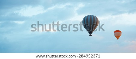 Two air balloons  in blue sky with empty space. Horizontal photo - stock photo