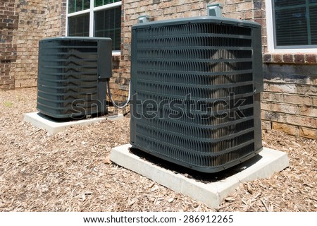 Two  air conditioning units - stock photo
