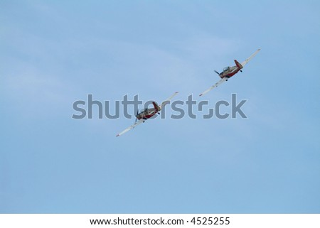 Two airplane doing aerial acrobatics at low altitude - stock photo