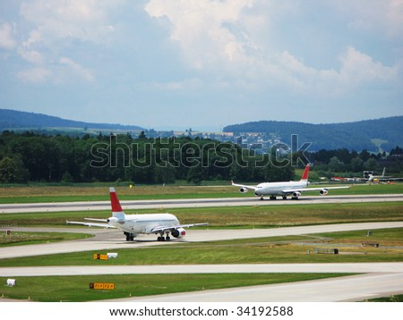 Two airplanes on the runway - stock photo
