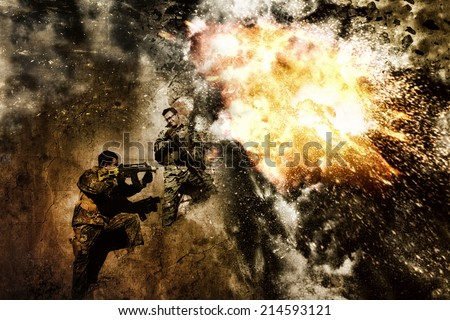 Two airsoft group team members crouch in defense of a massive resulting explosion. - stock photo