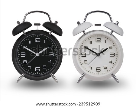 Two alarm clocks one Black and one White with the hands  set at 10 and 2 am or pm isolated on a white background with drop shadows