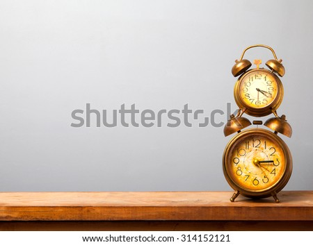 two alarms on the wooden table - stock photo