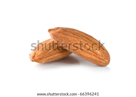 Two almond isolated on a white background - stock photo