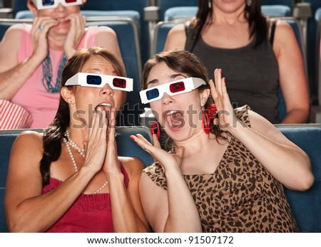 Two amazed Caucasian women with 3D glasses - stock photo