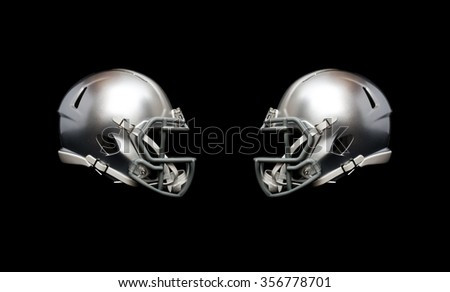 two american football helmet isolated on black background