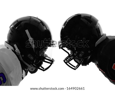 two american football players face to face in silhouette shadow on white background - stock photo