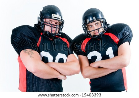 Two American football players isolated on white background - stock photo