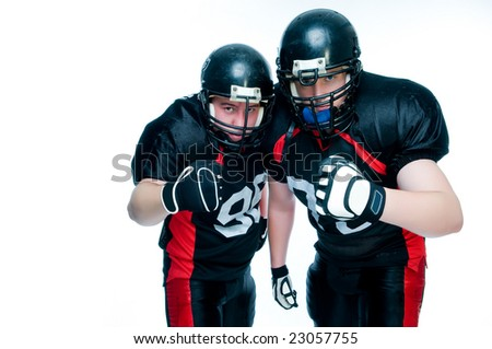 Two American football players over white background - stock photo