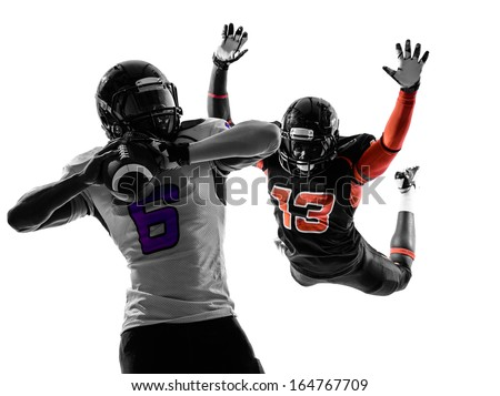two american football players quarterback sacked in silhouette shadow on white background - stock photo