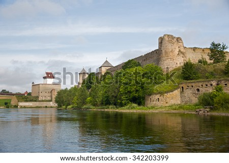 Two ancient fortress - Ivangorod, Russia and Narva, Estonia on the opposite banks of the river. - stock photo