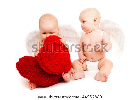 Two angelic baby friends in white diapers - stock photo