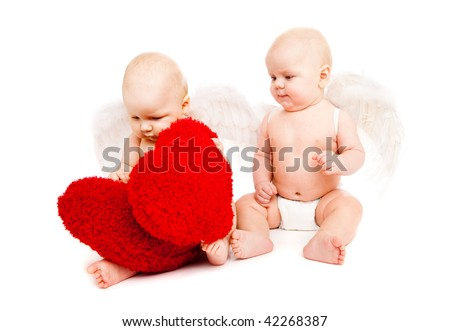 Two angelic baby friends playing with red hearts - stock photo