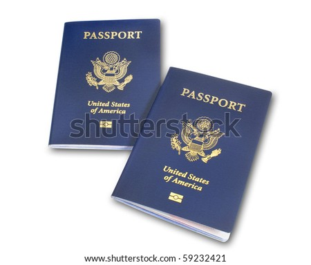 Two angled US passports isolated on white with shadow and clipping path - stock photo