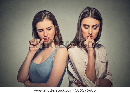 Two angry beautiful girls going through a conflict in their relationship life  - stock photo