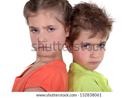 two angry kids posing together - stock photo