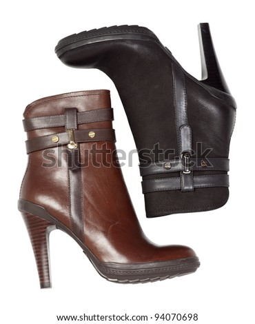 Two ankle-high women boots against white background - stock photo