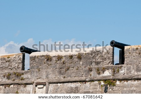 Two antique cannons on a fort - stock photo