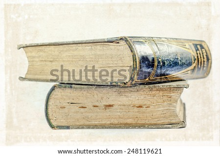 Two antique encyclopedia or dictionary on white background - stock photo