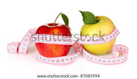 two apples and measuring tape isolated on white