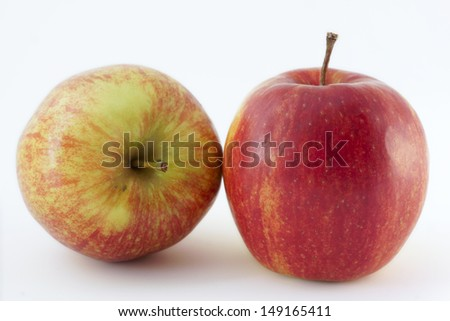 Two apples in the studio with a white background - stock photo