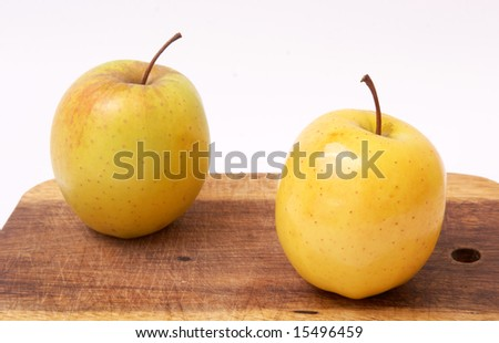 Two apples on a board