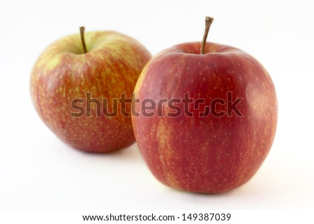 Two apples on white background - stock photo