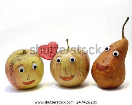 two apples with the heart and a PEAR that is watching - stock photo